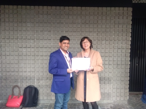 Mr. Sujit Ghosh from Tripura , India receiving the participation certificate from the lead coordinator of University of Milan